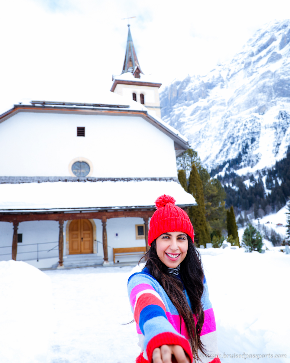 Girl in front of a church in Grindelwald Switzerland
