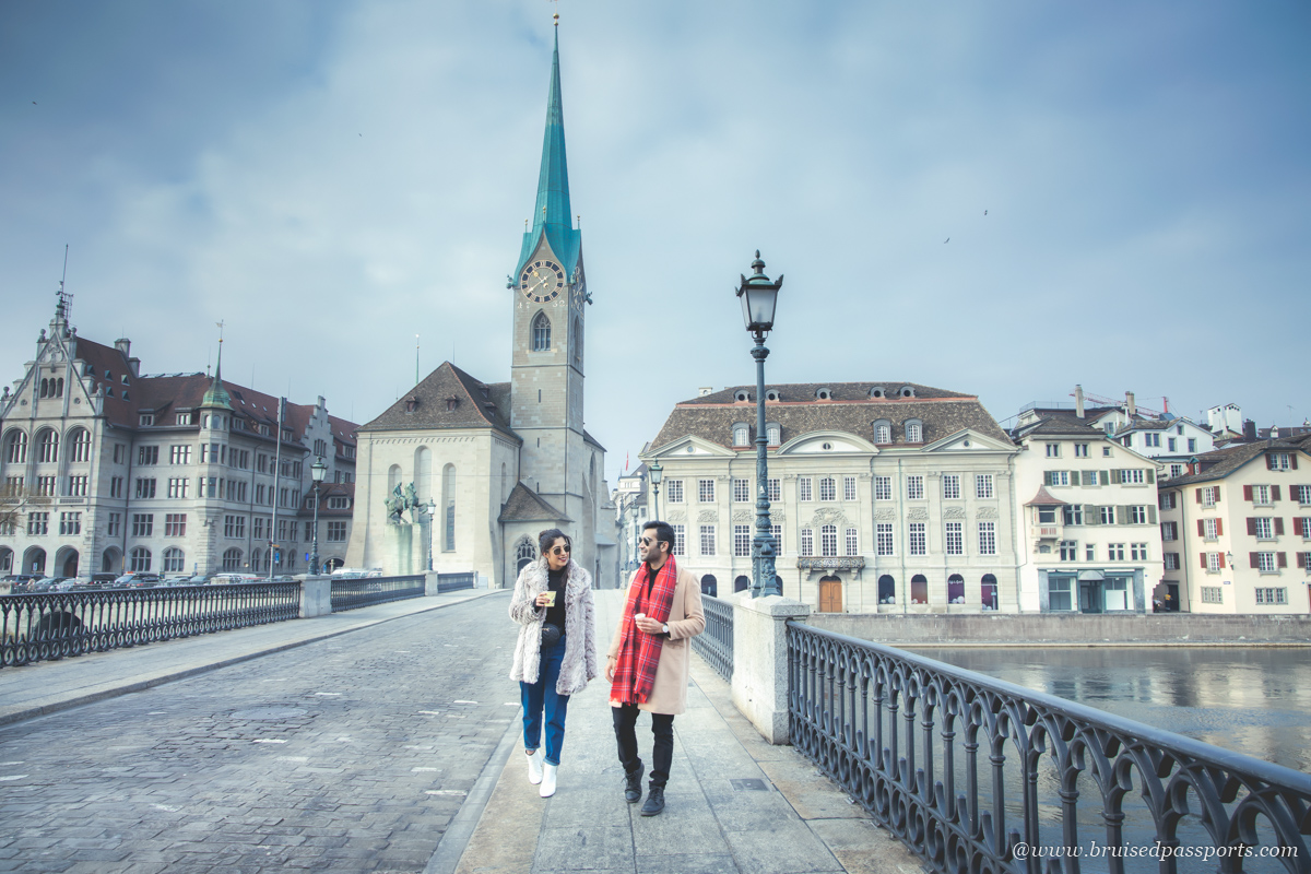 couple walking on bridge in Zurich