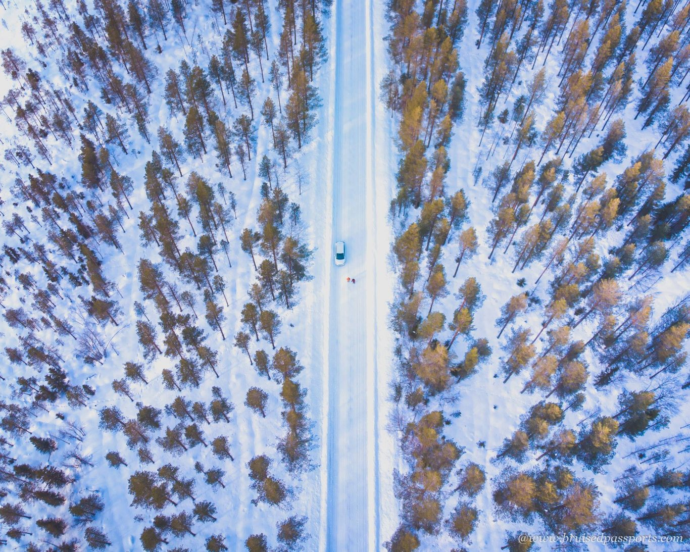 Winter road trip drone shot in Lapland