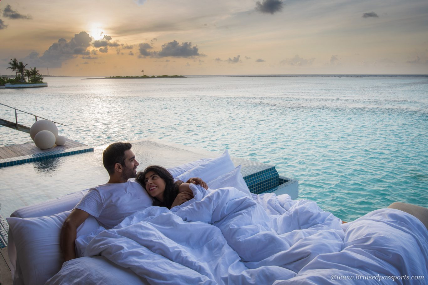 Sunrise at Club Med finolhu over water villas in Maldives