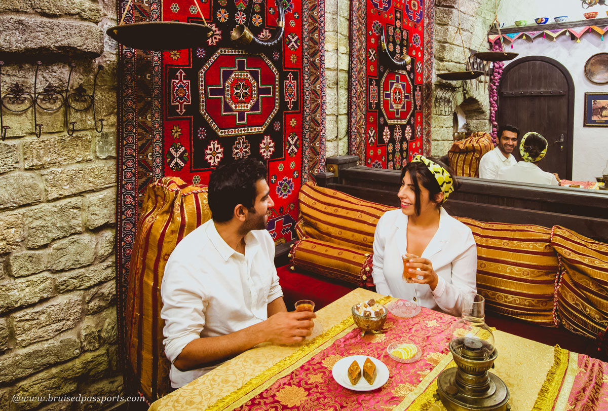 carpets and middle eastern decor in a dining room at Shirvanshah Museum Restaurant