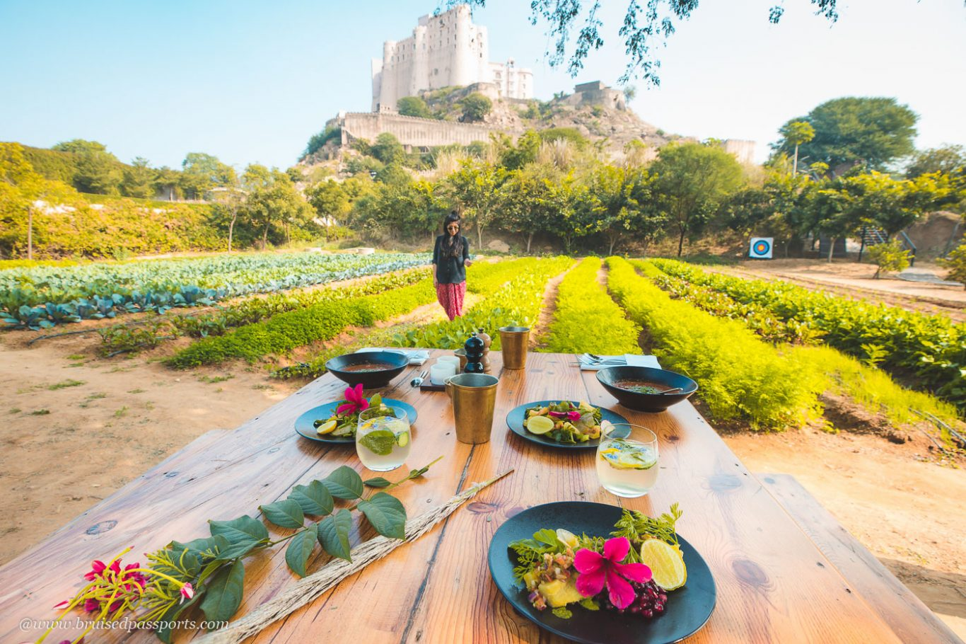 romantic lunch setting at Alila Fort Bishangarh in their organic garden